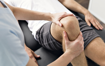 Physiotherapist treating back